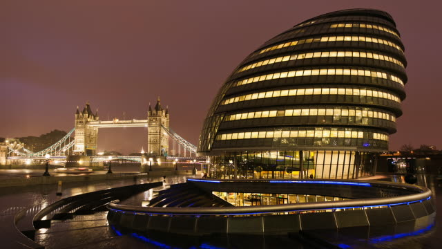 t/l london's city hall and the tower bridge at night / london, england, united kingdom - gla building stock videos & royalty-free footage