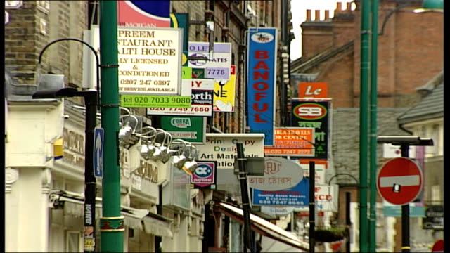 London's curry house industry is thriving EXT Numerous signs advertising Indian restaurants Close up of road sign Brick Lane ENDS