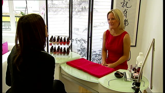 london's first beauty salon for cancer sufferers; rachel simkiss interview sot cutaways buddha statue woman having manicure in beauty salon purple... - massage table stock videos & royalty-free footage