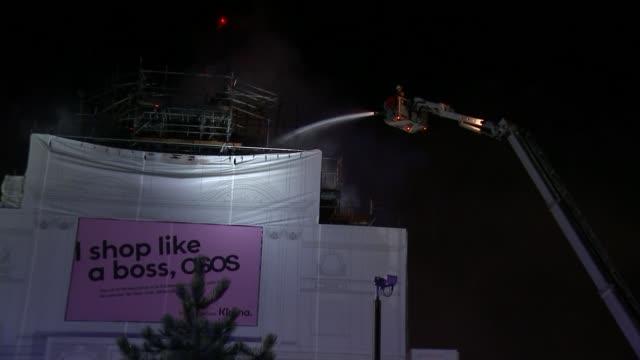 london's koko nightclub in camden badly damaged by fire; england: london: camden: ext jon hosking interview sot night fire fighters hosing down koko... - close up stock videos & royalty-free footage