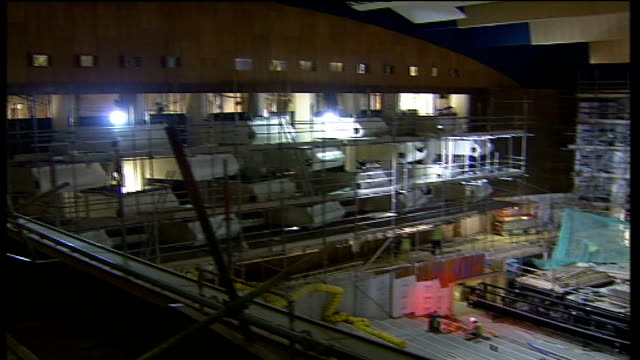 london's royal festival hall to open in june 2007 after major refit; high angle shot of scaffolding and workmen working on stage area - ロイヤルフェスティバルホール点の映像素材/bロール