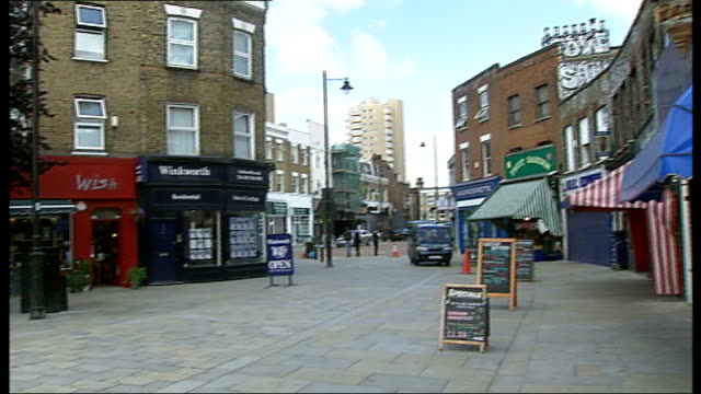 london's small shops fight for survival general view of local high street pan customers in local cafe ext blackboard advertising coffee and cakes for... - for sale englischer satz stock-videos und b-roll-filmmaterial