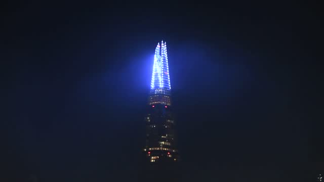 london's the shard was lit up in honour of the nhs and key workers who have worked on the front lines during the pandemic – with the annual christmas... - turning on or off stock videos & royalty-free footage