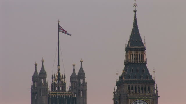 londonvictoria tower and big ben clock tower at magic hour in london united kingdom - victoria tower stock-videos und b-roll-filmmaterial