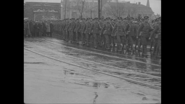 a lone british officer salutes his troops marching in the rain / marching soldiers following two white horses in the rain / lone saluting officer /... - 1910 stock videos & royalty-free footage