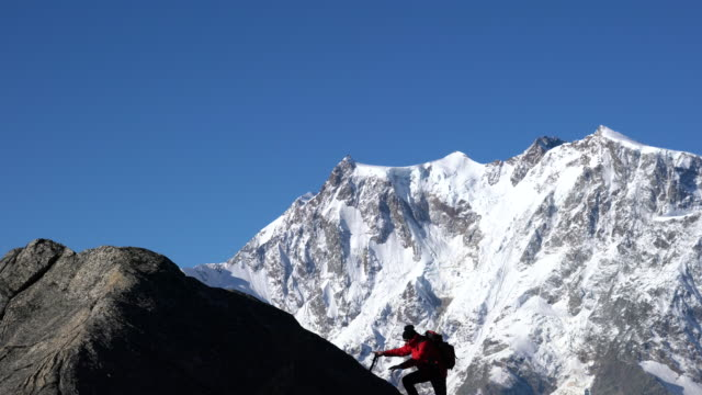 lone climber in the alps - moving up stock videos & royalty-free footage