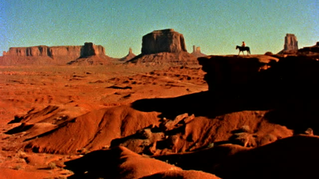 Lone Horseback Rider at Monument Valley
