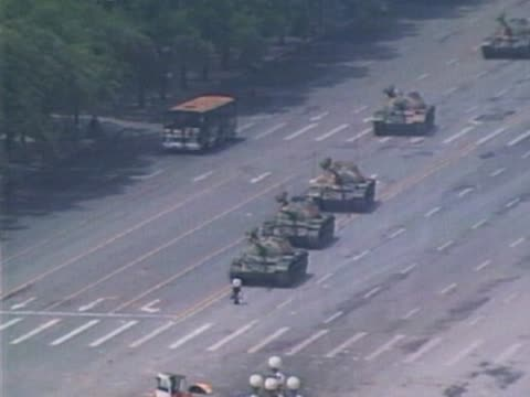 a lone man stops a convoy of tanks during the tiananmen square protests in beijing - tiananmen square stock videos & royalty-free footage