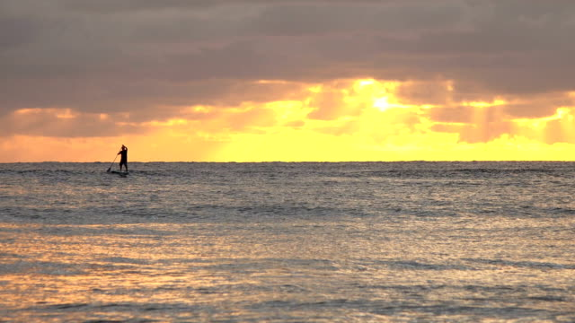 lone paddle boarder off coast of kauai island - butte rocky outcrop stock videos & royalty-free footage