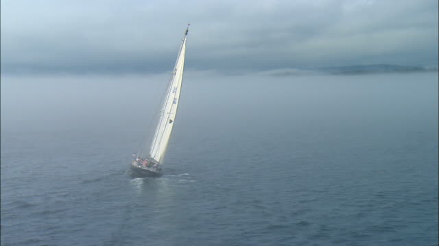 low aerial, lone sailboat in sea / camden, maine - unknown gender stock videos and b-roll footage
