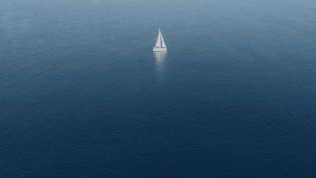 a lone sailing boat at anchor aerial view - yacht stock videos & royalty-free footage
