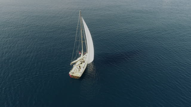 a lone sailing boat at anchor aerial view - solitude stock videos & royalty-free footage