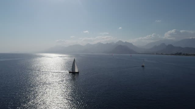 a lone sailing boat in antalya konyaaltı aerial view - resting stock videos & royalty-free footage