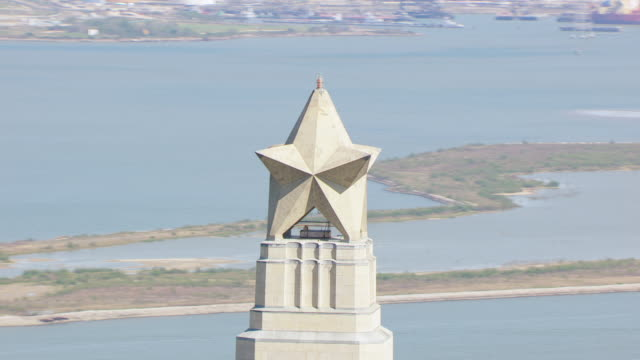 ms aerial cu lone star at top of san jacinto monument / houston, texas, united states - sea channel stock videos and b-roll footage
