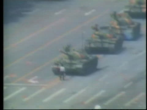 lone student tries to stop a column of tanks in tiananmen square. - tiananmen square stock videos & royalty-free footage