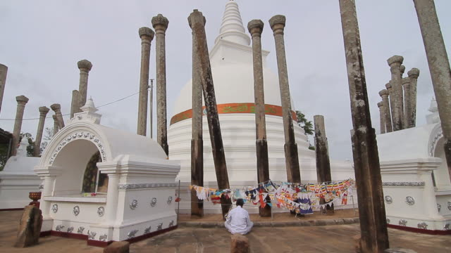 ms lone worshipper praying at thuparama dagoba, first dagaba built in sri lanka after introduction of buddhism, contains collarbone of buddha / anuradhapura, north central province, sri lanka - worshipper stock videos & royalty-free footage