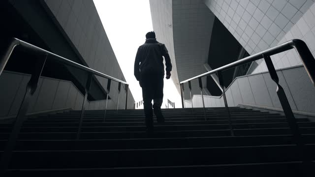 loneliness man walking up stairs - recreational pursuit stock videos & royalty-free footage