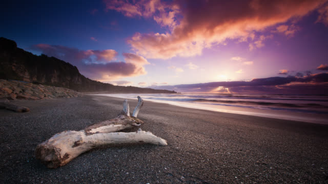 time lapse: lonely beach - new zealand stock videos & royalty-free footage