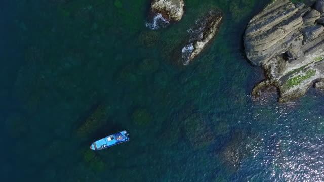 lonely boat in the sea - ankrad bildbanksvideor och videomaterial från bakom kulisserna