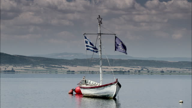 WS Lonely fishing boat on lake / Volvi, Serres, Greece