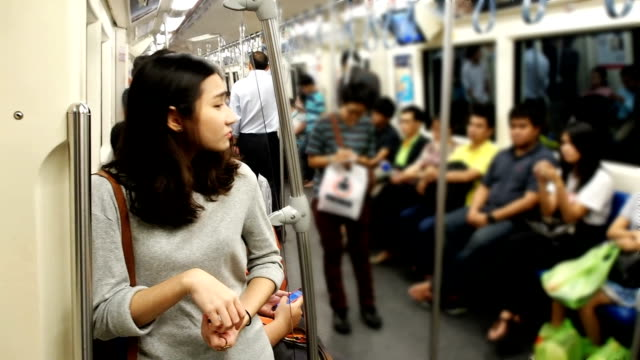 Lonely girl in subway train