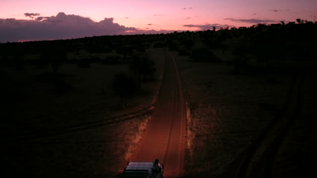 a lonely  is driving through the kalahari desert at night - solitude stock videos & royalty-free footage