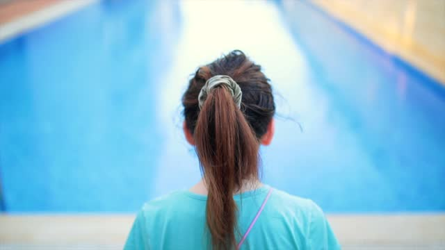 lonely little girl looking swimming pool at qyarantine days - 8 9 years stock videos & royalty-free footage