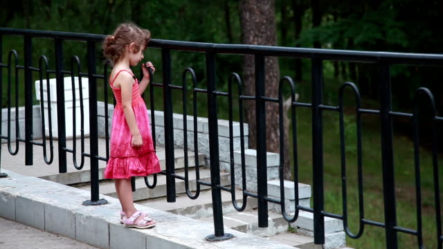 lonely little girl standing in front of the metal fence - sandal stock videos & royalty-free footage