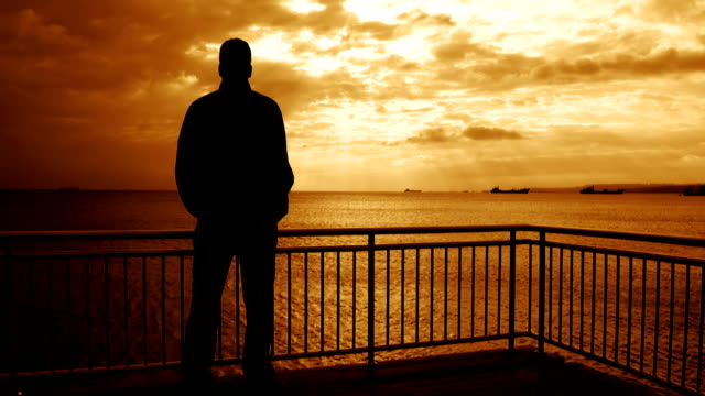 lonely man over the pier - silhouette stock videos & royalty-free footage