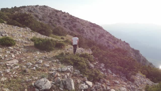 Lonely Man Standing At The Top of a Hill in Spil Mountain National Park, Manisa, Turkey