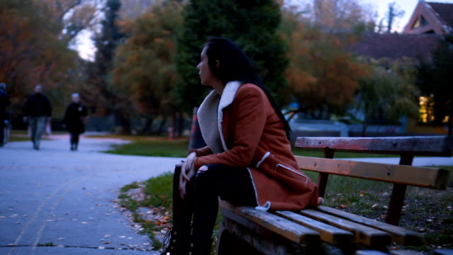 lonely sad woman siting on the bench - black hair stock videos & royalty-free footage