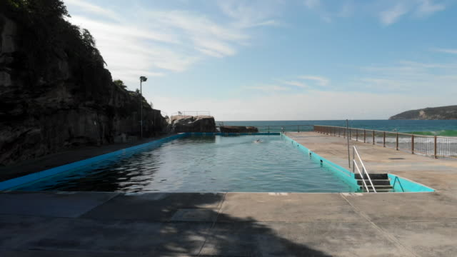 a lonely swimmer doing laps in ocean pool, manly beach, sydney - tourism stock videos & royalty-free footage
