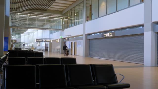 april 2020: lonely traveller at the airport hamburg fuhlsbüttel - passenger stock videos & royalty-free footage