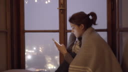 Lonely woman at home during Christmas