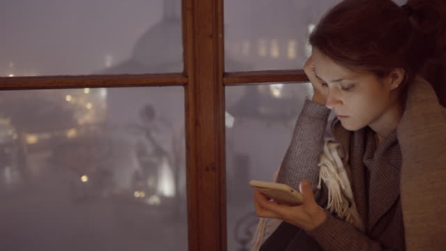 lonely woman at home during christmas - text messaging stock videos and b-roll footage