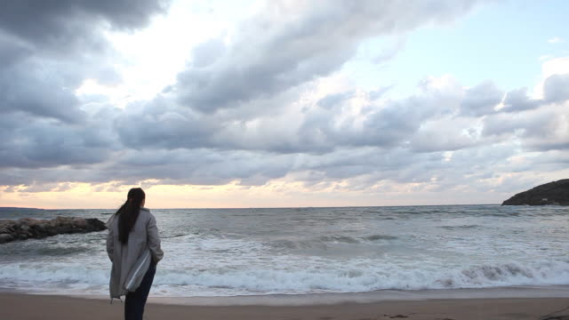 Lonely woman, gloomy day, beach