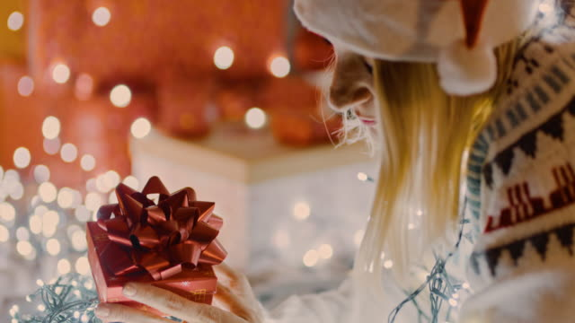 ds ms lonely woman looking at her christmas present - advent stock videos & royalty-free footage