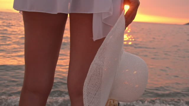 slo mo lonely woman on the beach at sunset - white shirt stock videos & royalty-free footage