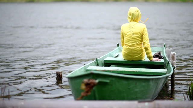 lonely woman on the boat - raincoat stock videos & royalty-free footage