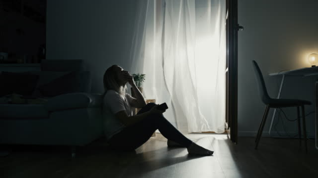 ds lonely woman sitting on the floor during the self isolation time - mid adult women stock videos & royalty-free footage