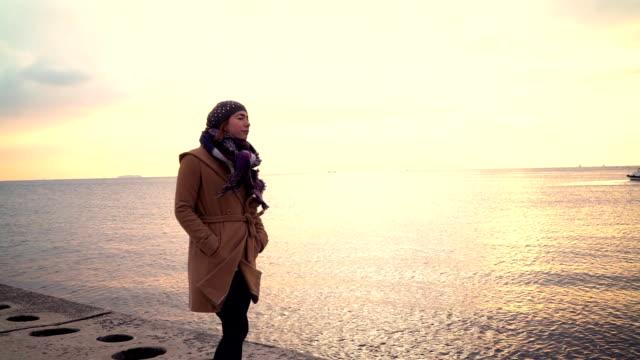 HD: Lonely Woman Walking at Seaside