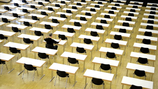 loner in the examination room, burn out, time lapse - auditorium stock videos and b-roll footage