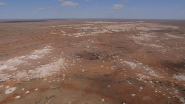 long, aerial shot of opal mining plains in australia. - gemstone stock videos & royalty-free footage