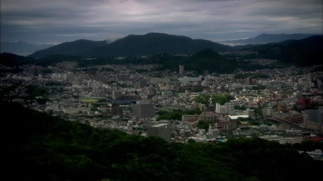 Long aerial shot of the city of Nagasaki