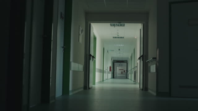 long and dark hospital hallway - dolly shot stock videos & royalty-free footage