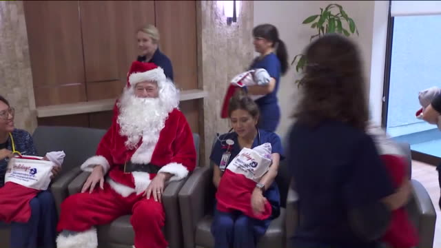 ktla long beach ca us newborns in christmas stockings at miller children's and women's hospital on tuesday december 23 2019 - baby girls stock videos & royalty-free footage