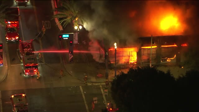 long beach, ca, u.s. – night aerial view of emergency services fighting fire of long beach shop, amid protests over george floyd death, on sunday,... - long beach california stock videos & royalty-free footage