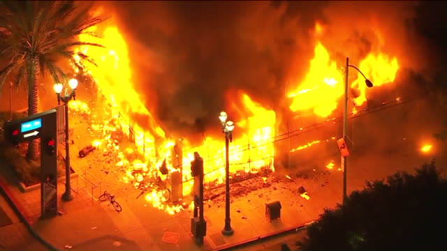 long beach, ca, u.s. – night aerial view of long beach shop on fire amid protests over george floyd death, on sunday, may 31, 2020. - long beach california stock videos & royalty-free footage