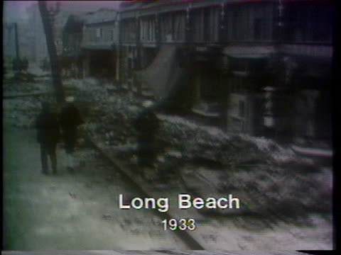 vídeos de stock, filmes e b-roll de long beach, california, suffers massive destruction after an earthquake in 1933. - 1933
