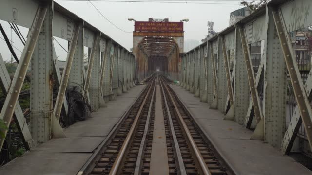 long bien bridge at hanoi. old rusty bridge with railroad - the past stock videos & royalty-free footage